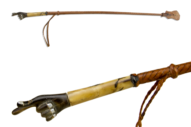 VERY UNUSUAL RIDING WHIP WITH A POINTED HAND POMMEL