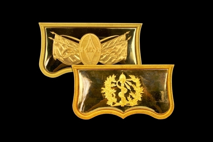 TWO GILDED POUCH FACING PLATES